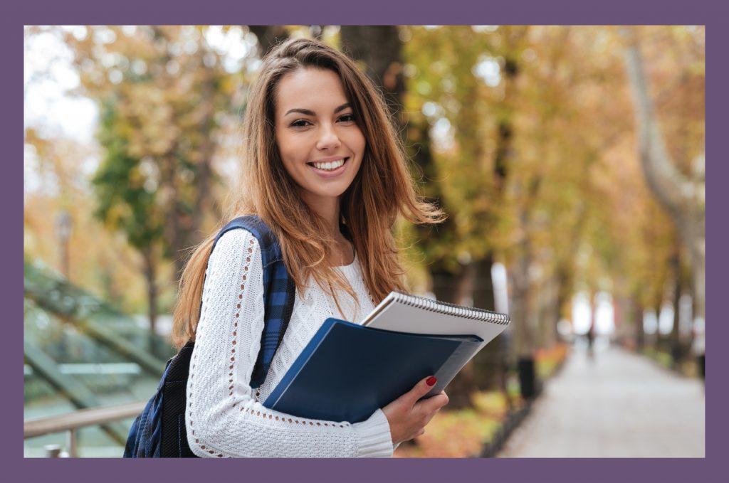Girl holding books in fall 03